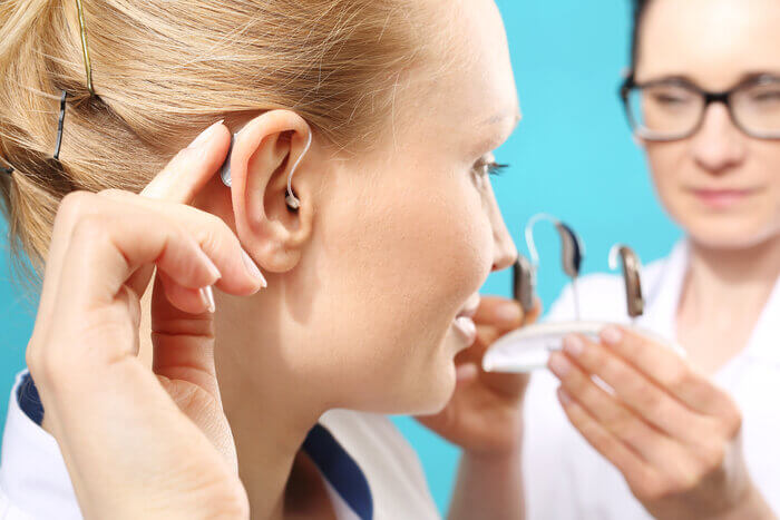 What does treating hearing loss with hearing aids say about you?